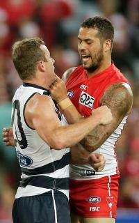 Steve Johnson and Lance Franklin get up close and personal