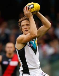 Former Lion Jared Polec in action for Port against Essendon during the NAB Challenge