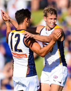 Sharrod Wellingham and Mark LeCras celebrate a West Coast goal during the Eagles' mauling of Freo