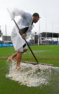 A groundsman tries to deal with the surface water in Mackay. Picture: Getty Images