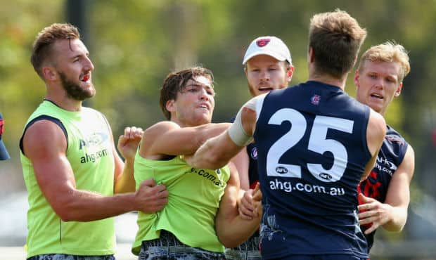 Jack Viney and Tom McDonald battle at Melbourne training on Tuesday