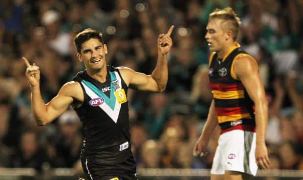 Bad weekend at Bernie's: Port's Chad Wingard salutes as Adelaide midfielder Bernie Vince looks on