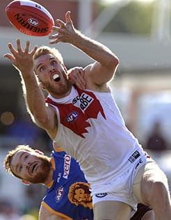 Lewis Roberts-Thomson marks in front of Daniel Merrett on Saturday. Picture: Getty Images