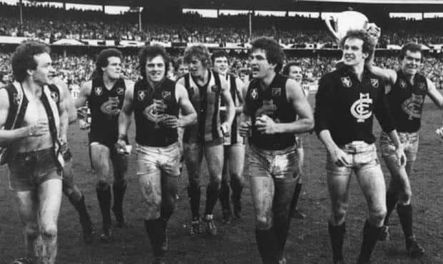 Carlton premiership wingman Michael Young, pictured here between Harmes and Johnston wearing the guernsey of his vanquished Collingwood opponent late on Grand Final day in 1979, has passed away after a long illness. - Carlton,Carlton Blues,AFL