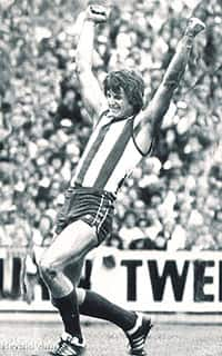 Arnold Briedis celebrates North Melbourne's win in the 1977 Grand Final replay - ${keywords}