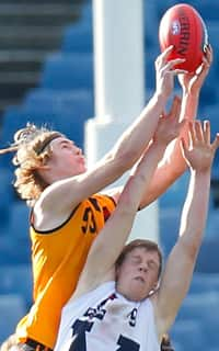 Cameron McCarthy soars for the mark that allowed him to kick the winning goal for WA over Vic Country