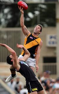 Orren Stephenson leaps high over Jarrad Redden in Richmond's big win