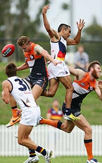 Lachie Whitfield and Eddie Betts fight for the ball during the practice match between the Giants and the Crows. Picture: Getty Images - ${keywords}