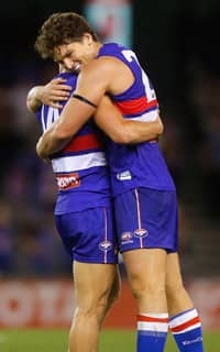 Will Minson and Clay Smith celebrate as the Bulldogs defeat the Brisbane Lions