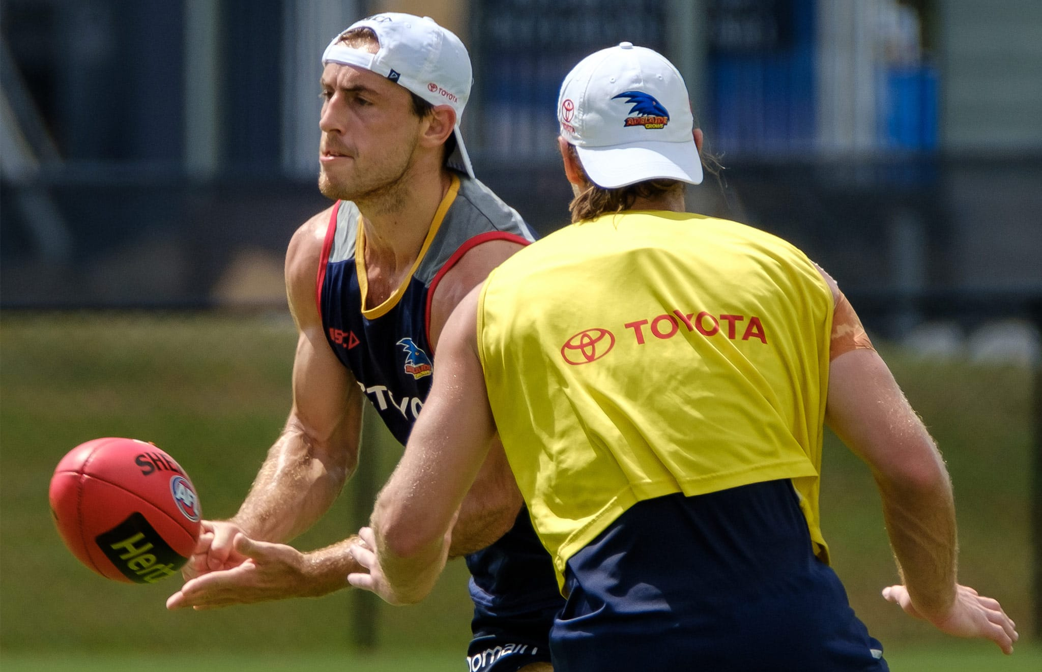 Richard Douglas fires out a handball at Adelaide's training camp on the Gold Coast - AFL,Adelaide Crows,Bryce Gibbs,Richard Douglas,Brodie Smith,Hugh Greenwood