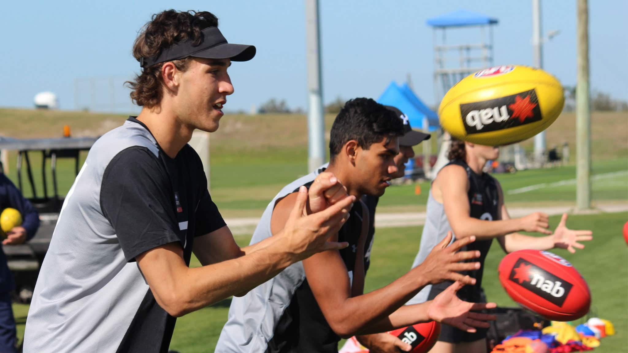 Max King fires out a handball in Academy training in Florida - AFL Academy,AFL,Max King,Draft