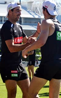 Steele Sidebottom congratulates Tom Phillips after the youngster's time trial win. Picture: Collingwood Media