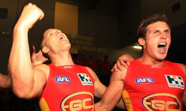 Gary Ablett and David Swallow belt out a rousing rendition of the Suns' song - ${keywords}