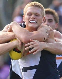 Adam Treloar in action for the Giants