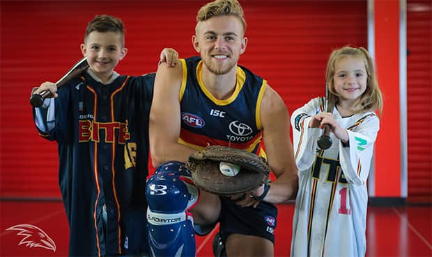 Crows midfielder Hugh Greenwood with two young Adelaide Bite fans