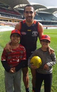 Eddie Betts with Indigenous twins Phrasswell and Wyatt, who will be team mascots on Saturday night at Adelaide Oval