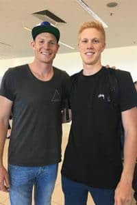 Sam Jacobs with Elliott Himmelberg at Adelaide Airport