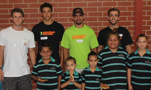 Crows players helping out with the Kickstart for Kids breakfast program