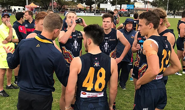 Crows SANFL coach Ryan O'Keefe addresses Adelaide's defensive group at a quarter break