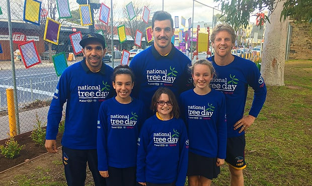Eddie Betts, Taylor Walker and Rory Sloane with kids from Goodwood Primary School for Schools Tree Day