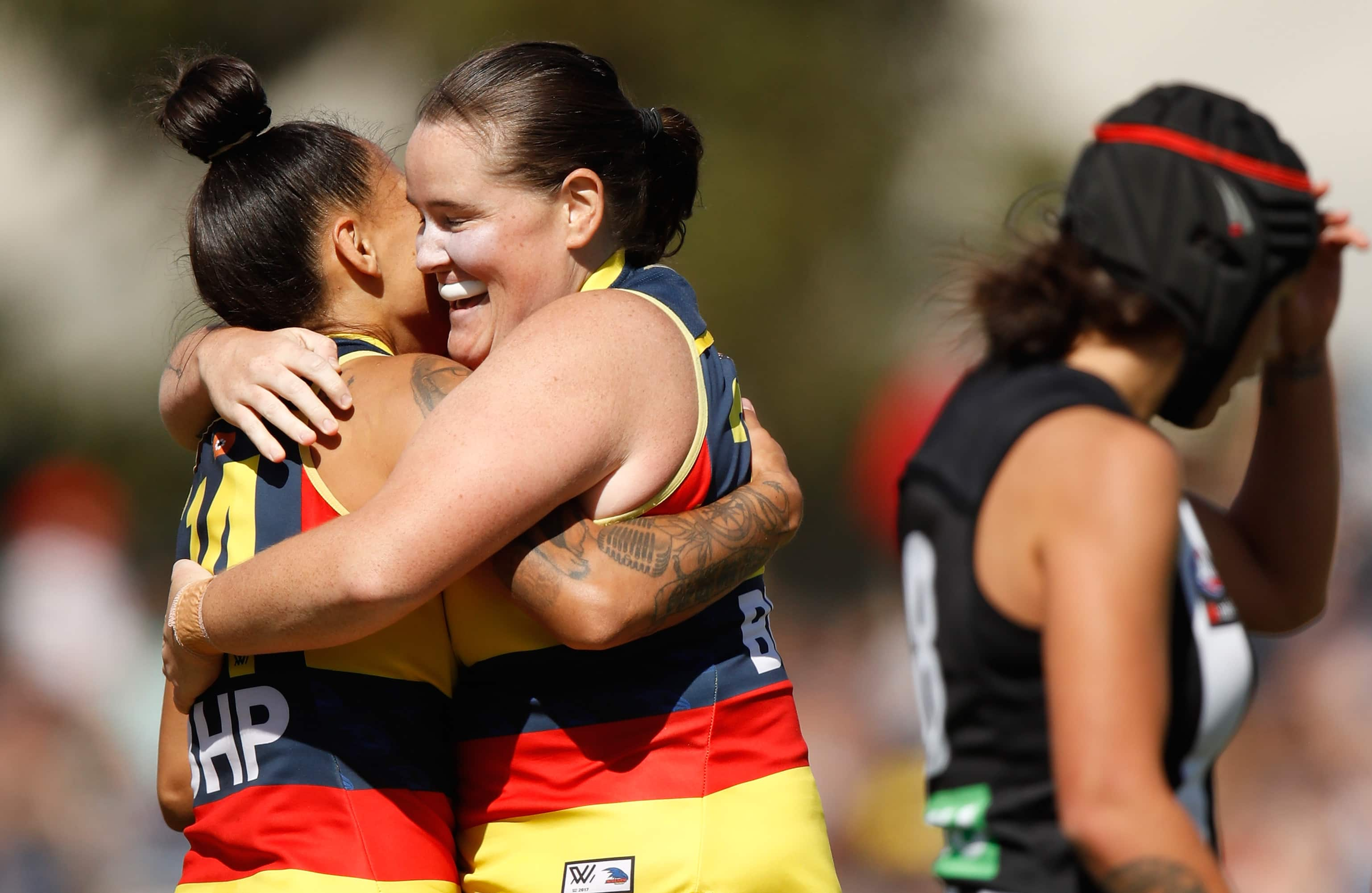 MELBOURNE, AUSTRALIA - MARCH 18: Stevie-Lee Thompson (left) and Sarah Perkins of the Crows celebrate during the 2018 AFLW Round 07 match between the Collingwood Magpies and the Adelaide Crows at Olympic Park Oval on March 18, 2018 in Melbourne, Australia. (Photo by Michael Willson/AFL Media)