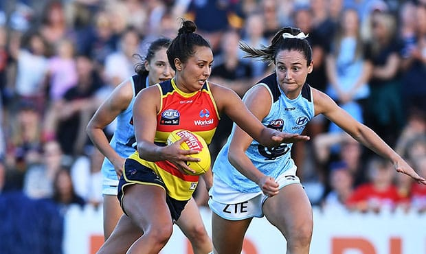 ADELAIDE, AUSTRALIA - MARCH 03:  Ruth Wallace of the Adelaide Crows heads for goal during the round five AFLW match between the Adelaide Crows and the Carlton Blues at Norwood Oval on March 3, 2018 in Adelaide, Australia.  (Photo by Mark Brake/Getty Images/AFL Media)