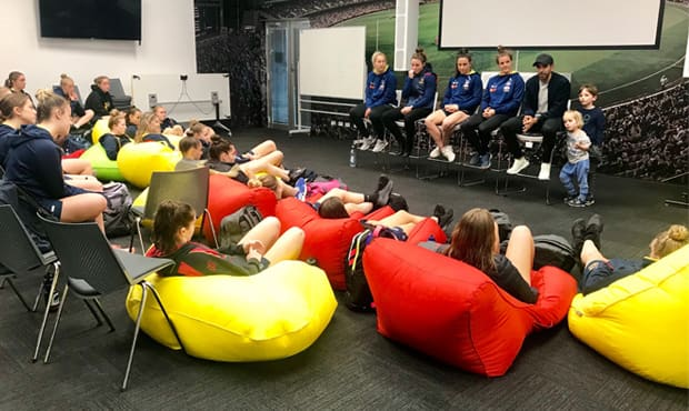 Marijana Rajcic, Jenna McCormick, Jess Sedunary, Sally Riley and Eddie Betts speak to the squad