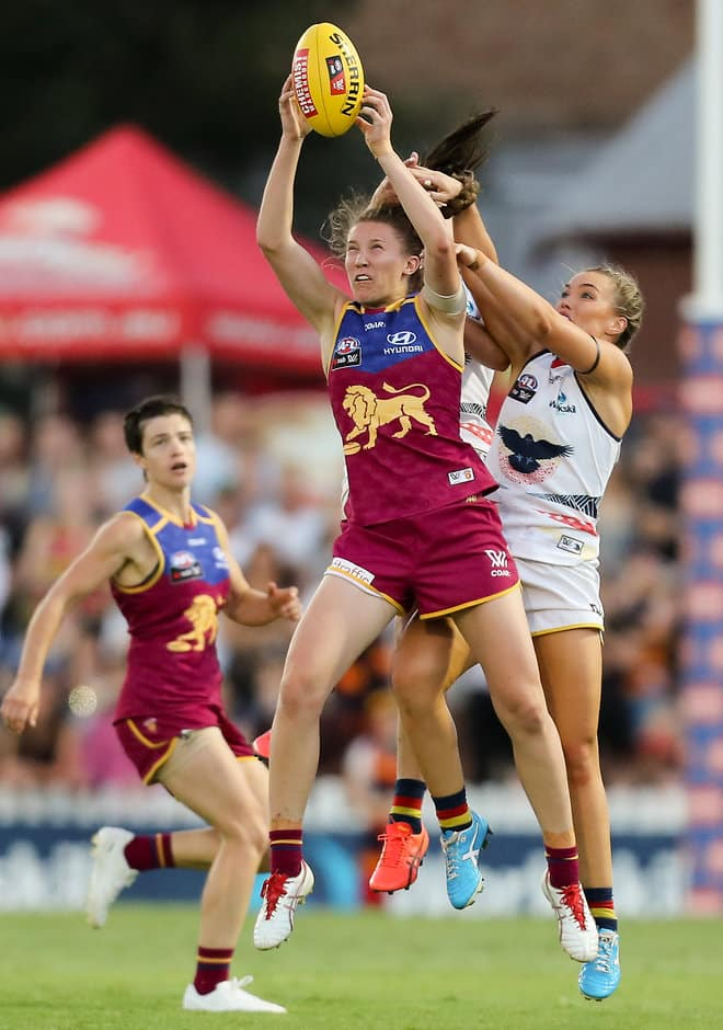 ADELAIDE, AUSTRALIA - MARCH 4: Tahlia Randall of the Lions marks in front of Jessica Sedunary and Abbey Holmes of the Crows during the 2017 AFLW Round 05 match between the Adelaide Crows and the Brisbane Lions at Norwood Oval on March 4, 2017 in Adelaide, Australia. (Photo by AFL Media)
