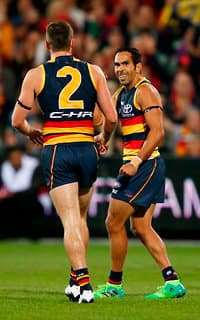 ADELAIDE, AUSTRALIA - MAY 13: Brad Crouch and Eddie Betts of the Crows celebrate a goal during the 2017 AFL round 08 match between the Adelaide Crows and the Melbourne Demons at the Adelaide Oval on May 13, 2017 in Adelaide, Australia. (Photo by James Elsby/AFL Media)