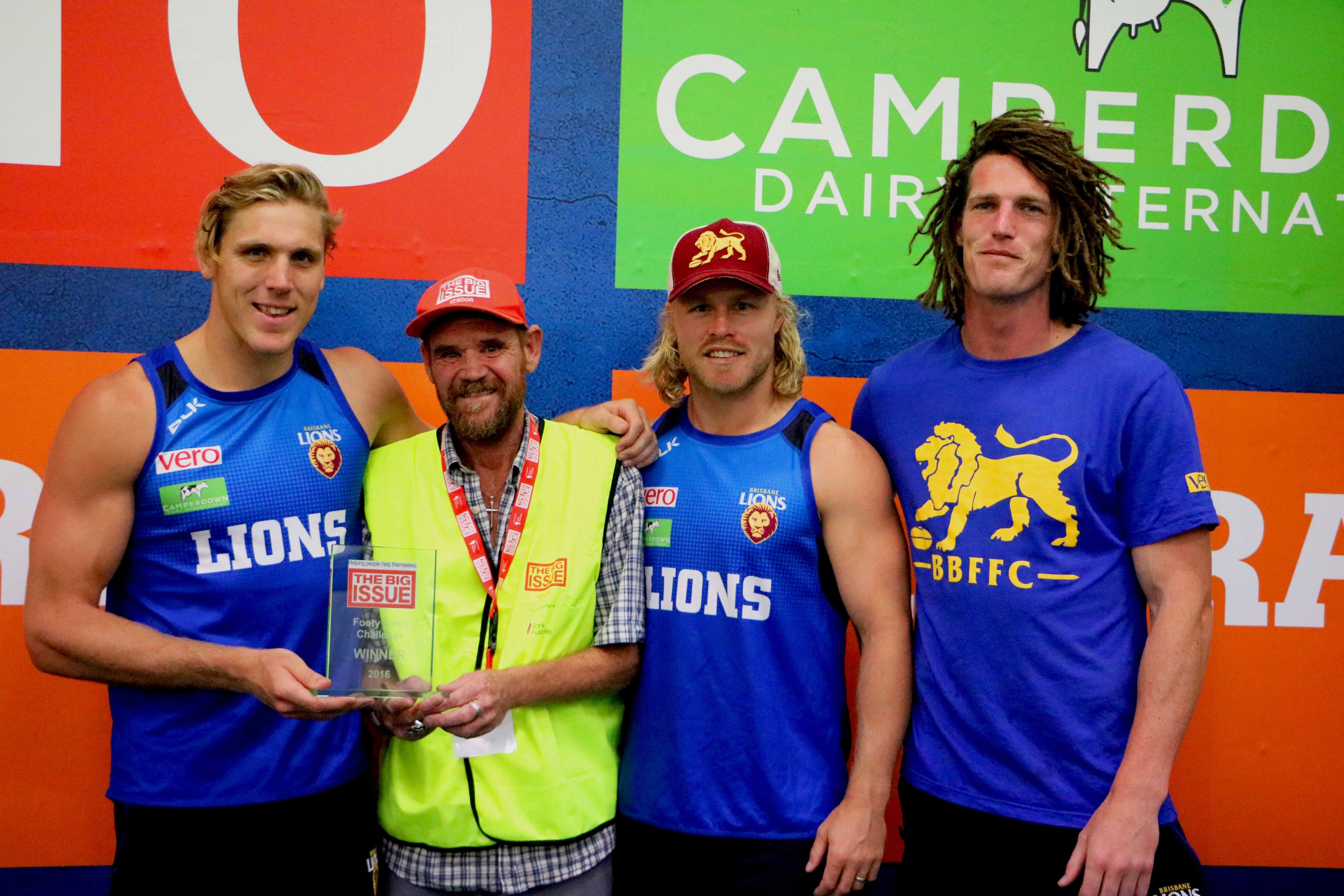 Magoo presents Tom Bell, Daniel Rich and Matty Eagles with the inaugural trophy.