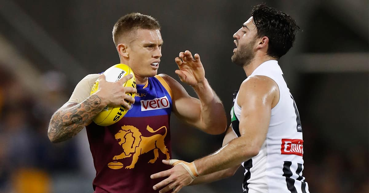 Dayne Beams of the Lions fends of Alex Fasolo of the Magpies during the 2016 AFL Round 08 match between the Brisbane Lions and the Collingwood Magpies at The Gabba, Brisbane on May 14, 2016. (Photo by Michael Willson/AFL Media)