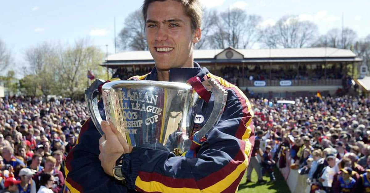 Simon Black clutches the Premiership Cup at the Brunswick St Oval back in 2003. - Simon Black,Brisbane Lions