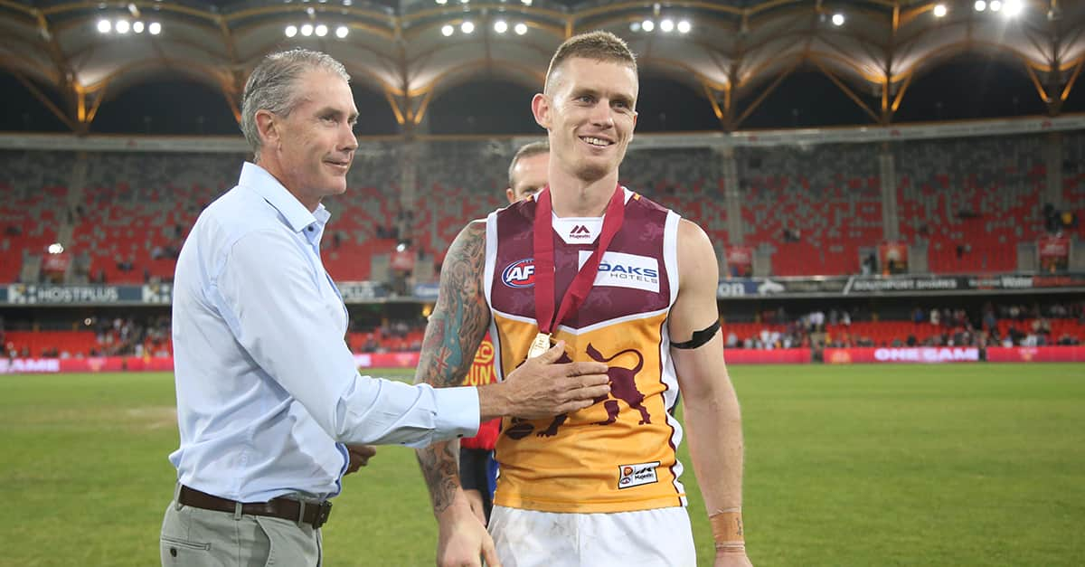 :Dayne Beams of the lions celebrates winning the Marcus Ashcroft Medal in QClash 16. - Brisbane Lions