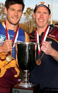 Nathan Clarke holds aloft the 2012 NEAFL Premiership Cup with Cheynee Stiller