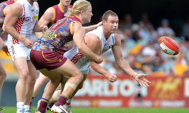 David Armitage is tackled by Daniel Rich at the Gabba last year.