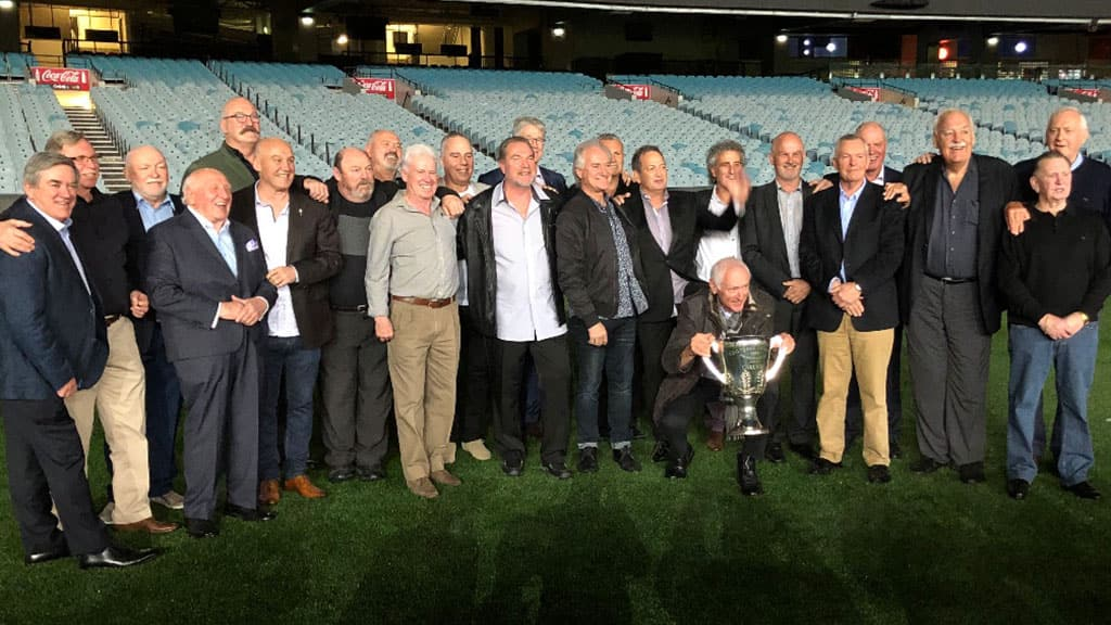 Former Carlton players and officials of the Premiership year of 1979 gather with the silverware on the MCG - Carlton,Carlton Blues,AFL