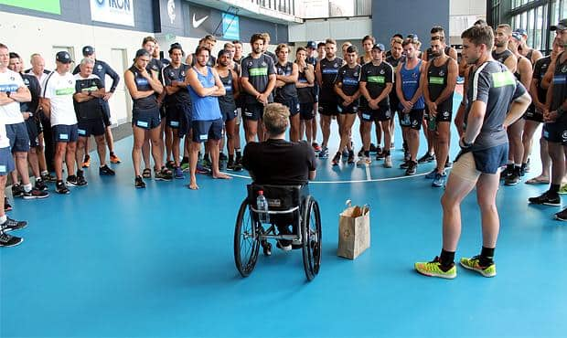 Dylan Alcott speaks to the Carlton players and coaching staff. (Photo: Carlton Media)
