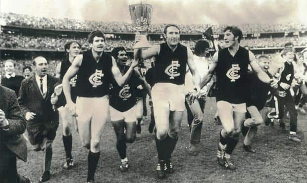 John Nicholls leads the victory lap for the 1970 Grand Final. Brian Bearman is pictured on the far left wearing the tie. (Photo: C & J Stuckey Pty Ltd Photographics)