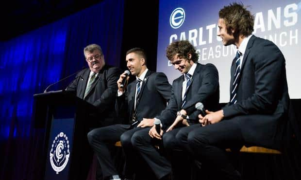 Kade Simpson, joined by Dylan Buckley and Dillon Viojo-Rainbow, speaks to the audience at the Carltonians' Season Launch. (Photo: Carltonians)