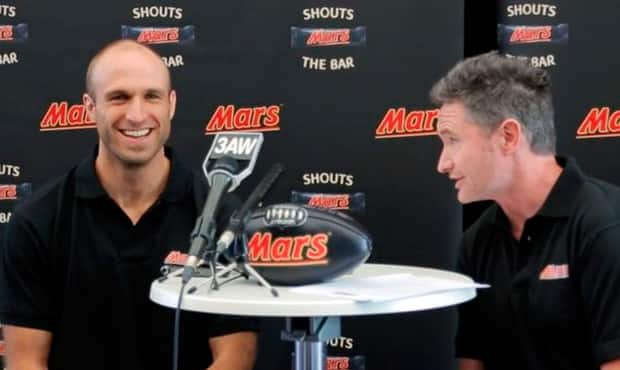 Carlton's Chris Judd with NOVA 100's Dave Hughes at Tuesday's MARS announcement.