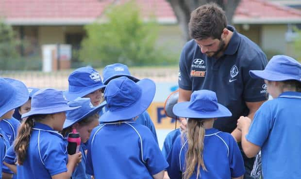 Levi Casboult meets some young fans at the 2014 Community Camp in Sale. (Photo: Carlton Football Club)
