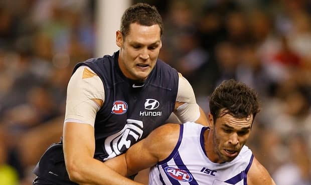 Carlton's Robert Warnock pressures Fremantles Ryan Crowley during the 2013 NAB Cup Round 2 match between the Carlton Blues and the Fremantle Dockers at Etihad Stadium, Melbourne. (Photo: Andrew White/AFL Media)