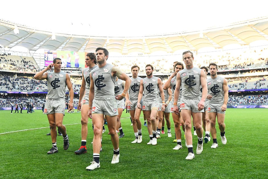 Carlton players leave the field after losing to Fremantle this year in the grey strip - AFL,Carlton Blues