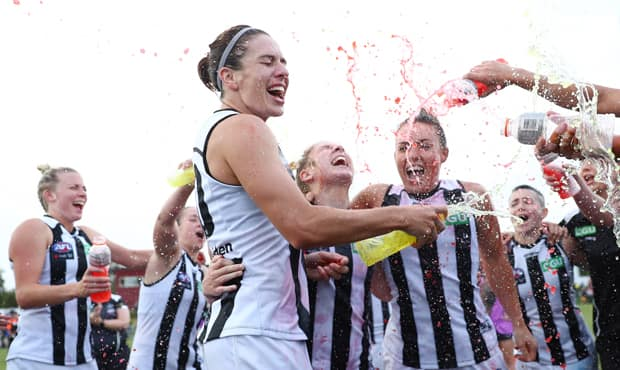 Ash Brazill, Georgie Parker and Kristy Stratton celebrate their first victory of their Collingwood careers. (Image; AFL Photos) - Collingwood,Collingwood Magpies,AFLW