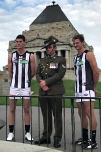 Henry Schade and Will Hoskin-Elliott meet Afghanistan veteran Chris May at the Shrine of Remembrance. Photo: Collingwood Media.