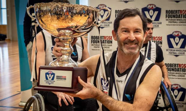 Richard Amon celebrates with the premiership trophy after a nine-goal performance against Richmond in the Grand Final. Image: Nerissa Turner Photography. - Collingwood,Collingwood Magpies