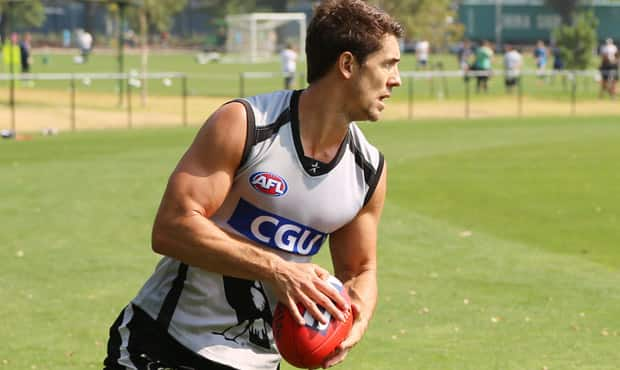 Jordan Russell swings onto the right boot during a kicking drill during Monday's training session.