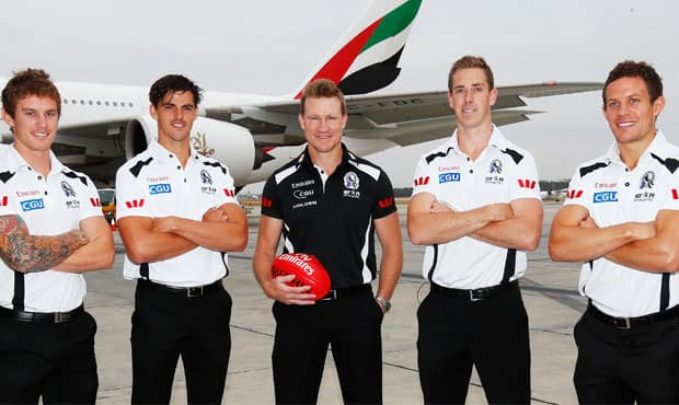 Dayne Beams, Scott Pendlebury, Nathan Buckley, Nick Maxwell and Luke Ball pose for photographers at Melbourne Airport after the 2013 leadership group announcement on Tuesday morning.