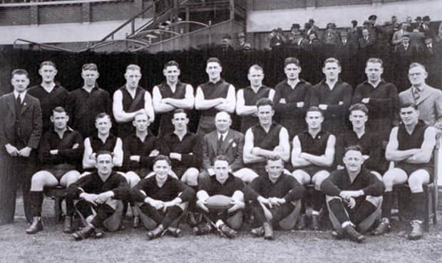 Back: Syd Carman (treas.), Gordon Abbott, Ted Leehane, George Pattinson, Perc Bushby, Norm Betson, Jack Cassin, Allan Hird, Wally Buttsworth, Harry Lee (sec.)  Middle: Tom Reynolds, 'Duffy' Plummer, Ern Coward, Dick Reynolds (captain-coach) Wally Crichton (pres), Hugh Torney, Laurie Dearle, Sid Silk, Bob Flanigan Front: Murray Exelby, Bill Hutchison, Ray Powell, Jack Caesar, Cec Ruddell
