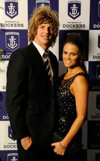 Nat Fyfe on the Purple Carpet with his partner Kaidee Arnold.
